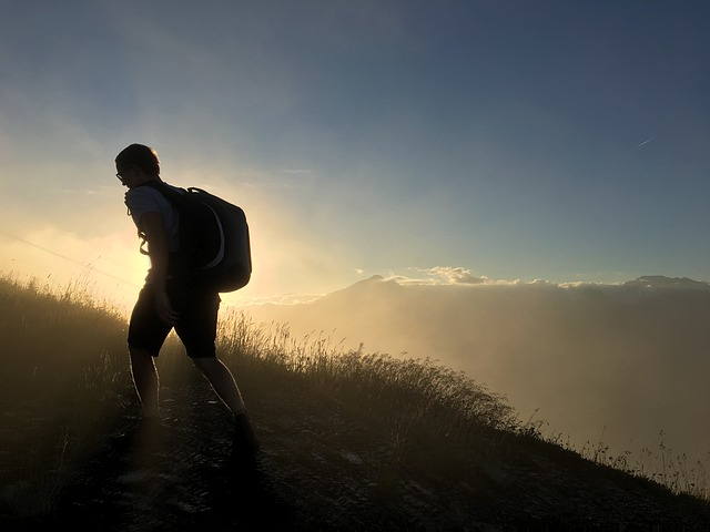a hiker in the sunset