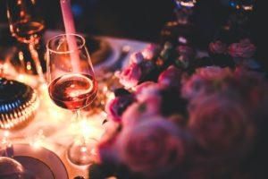 Glass of wine on a fancy dinner table