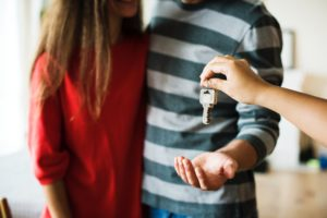 A couple receiving keys to a home